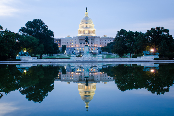 Image showing the U.S. Capitol and its reflection on water.