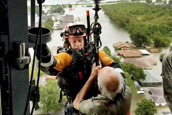 Texas Task Force 1 helicopter rescues flood victims after Harvey