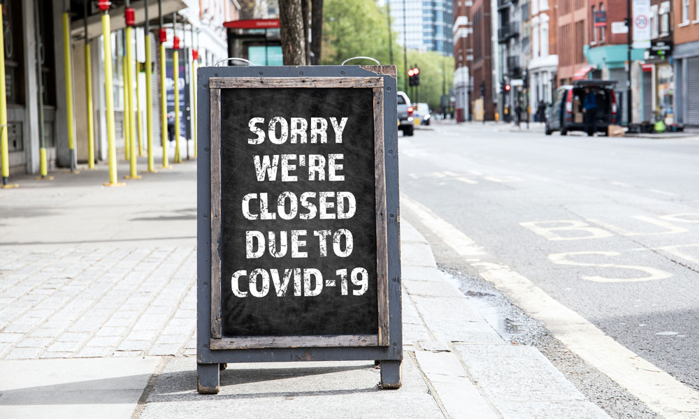 Photo of sign saying business is closed because of COVID-19